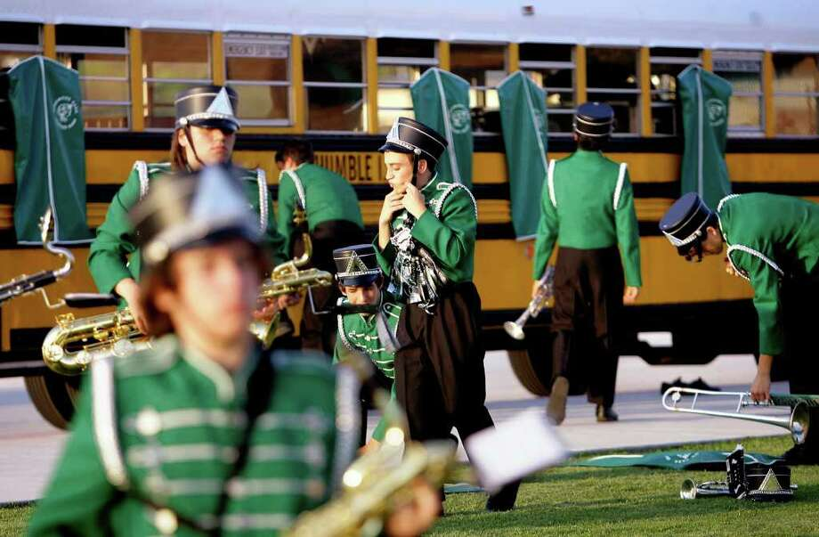 Kingwood Park High School band members prepare before the start of a football game against Summer Creek High School at Turner Stadium. Photo: Cody Duty, Houston Chronicle / © 2011 Houston Chronicle