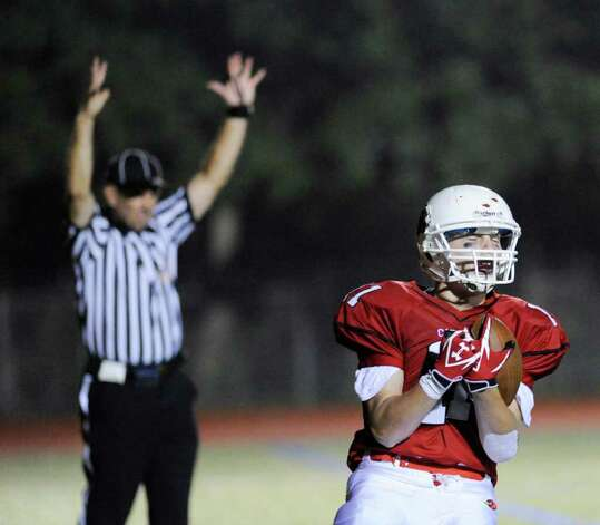 Running back Alex McMurray of Greenwich High School, # 11, reacts after scoring on a run during High School football game between New London High School and Greenwich High School at Greenwich, Friday night, Sept. 30, 2011.  New London defeated Greenwich 51-33. Photo: Bob Luckey / Greenwich Time