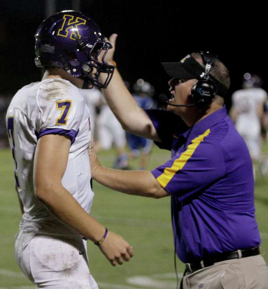 Quarterback Ford Childress of the Kinkaid Falcons is congratulated by head coach Stephen Hill  after Childress through a touchdown pass against  Episcopal. Photo: For The Chronicle: Thomas B. She