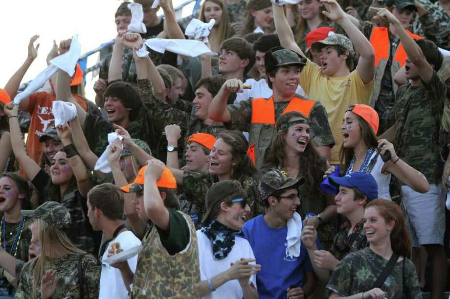 The Episcopal Knights fans wore camoflage because they said they were hunting Falcons. Photo: For The Chronicle: Thomas B. She