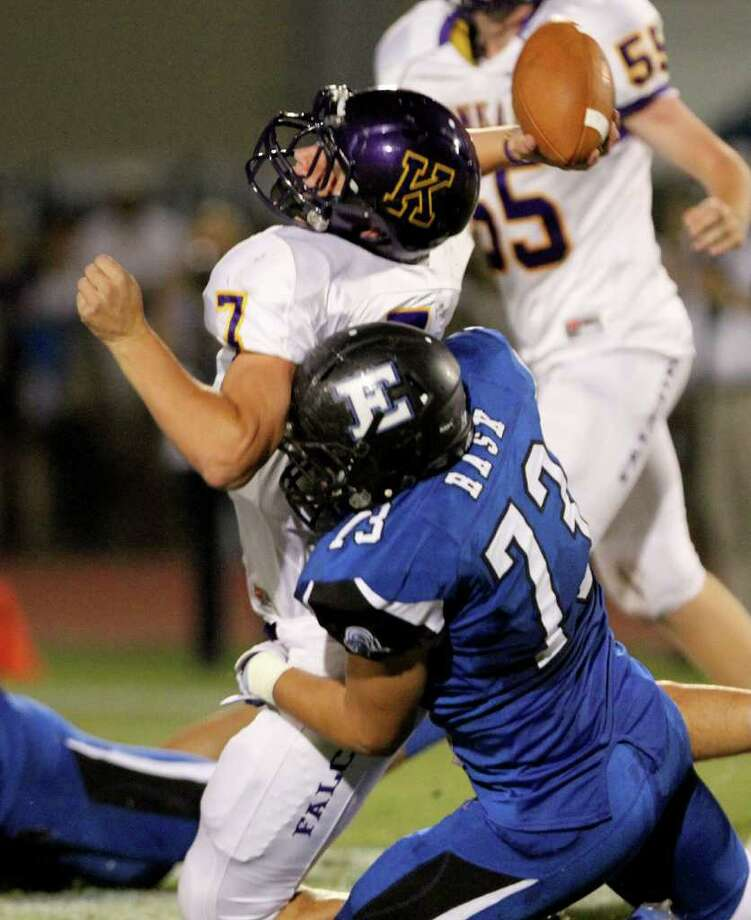 Quarterback Ford Childressof the Kinkaid Falcons is sacked by lineman Johan Rask of the Episcopal Knights. Photo: For The Chronicle: Thomas B. She