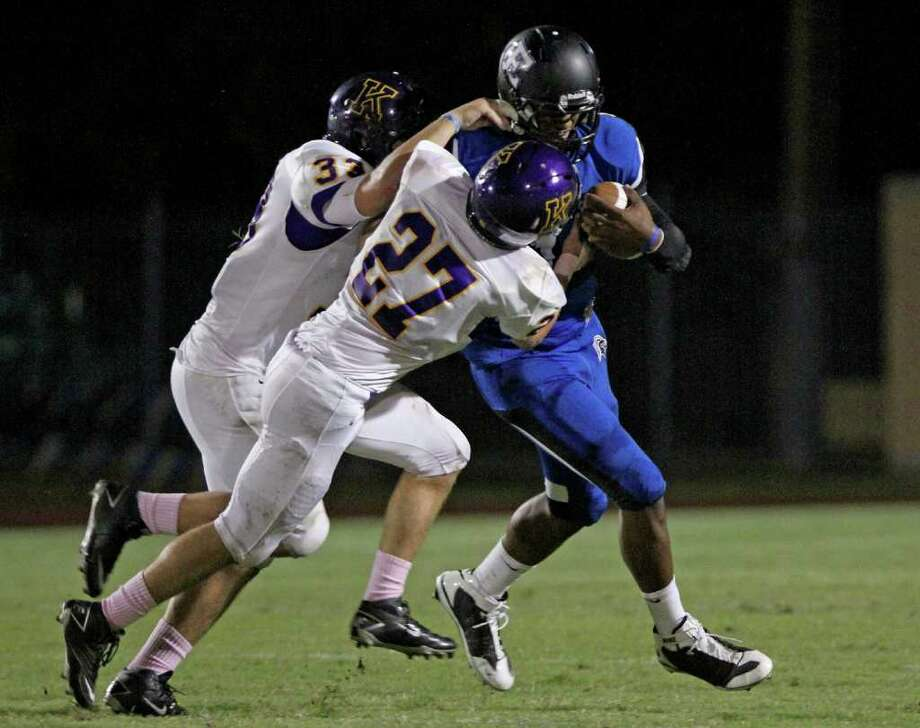 Quarterback Austin Robinson of Episcopal  is sacked by Kincaid lineman Wells Johnson (33) and J.Johnson (27). Photo: For The Chronicle: Thomas B. She