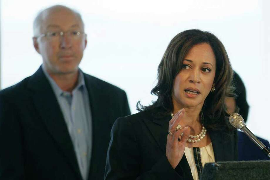 California Attorney General Kamala Harris, right, speaks in front of U.S. Interior Secretary Ken Salazar, left, at a news conference in Treasure Island, Calif., Monday, Sept. 19, 2011. The companies responsible for the 2007 oil spill in San Francisco Bay have agreed to pay the government $44.4 million for the cleanup costs. Salazar, Harris and other officials announced the proposed deal Monday. It would settle several lawsuits filed against Hong Kong-based Fleet Management Ltd. and Regal Stone Ltd. (AP Photo/Jeff Chiu) Photo: Jeff Chiu / AP