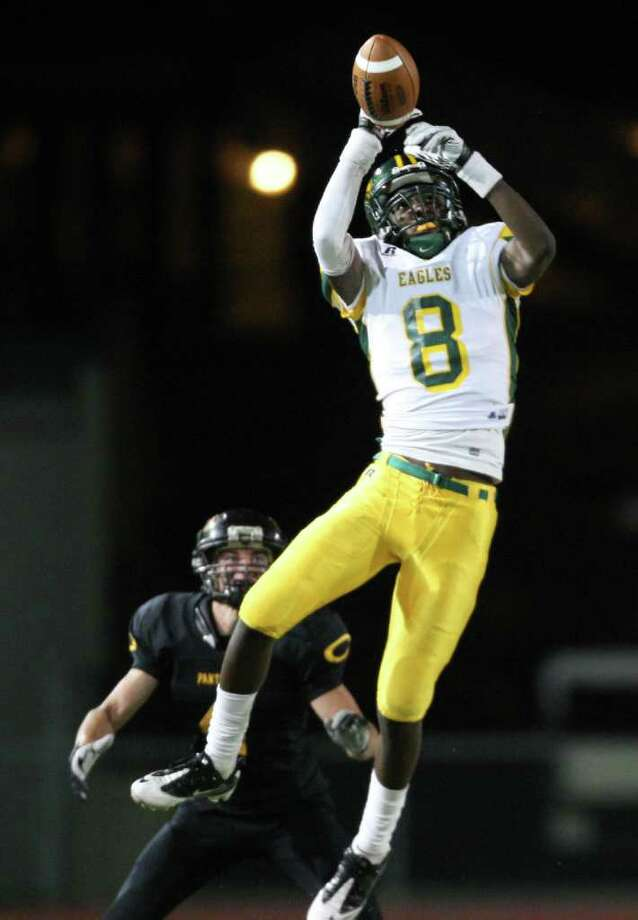 Klein Forest's Markel Steward-Gillespie (8) makes a reception in front of Klein Oak's Cody Spiegelhauer. Photo: Eric Christian Smith, For The Chronicle