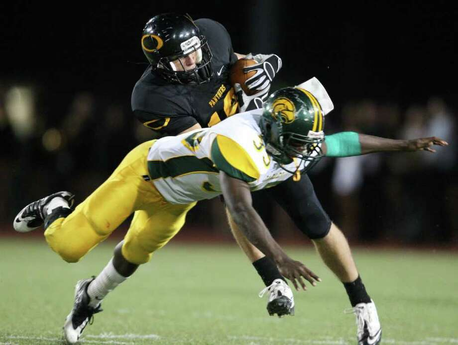 Klein Oak's James Dorris (18) intercepts a pass intended for Klein Forest's Anthony Brisco late in the second quarter. Photo: Eric Christian Smith, For The Chronicle