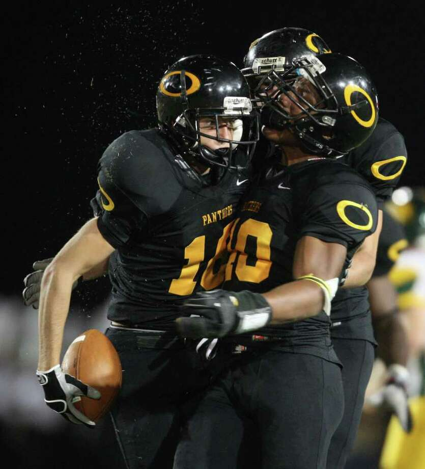 Klein Oak's James Dorris (left) celebrates with teammates his second quarter interception of Klein Forest's Matt Davis during the second quarter. Photo: Eric Christian Smith, For The Chronicle