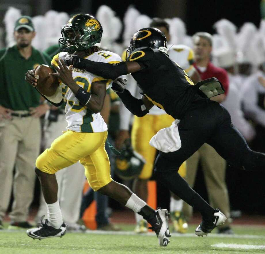 Klein Forest's Anthony Austin intercepts a pass intended for Klein Oak's Torence Porter. Photo: Eric Christian Smith, For The Chronicle