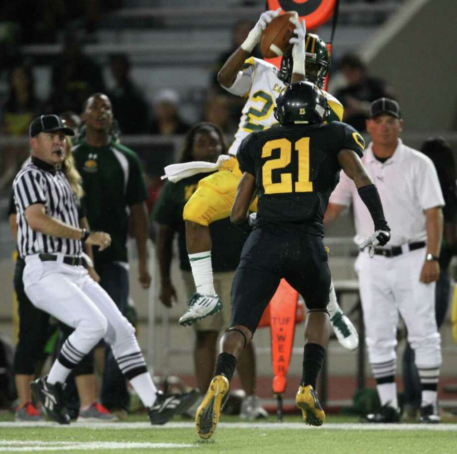Klein Forest's Trent Richmond makes a reception past Klein Oak's Dashone Smith during the first half. Photo: Eric Christian Smith, For The Chronicle