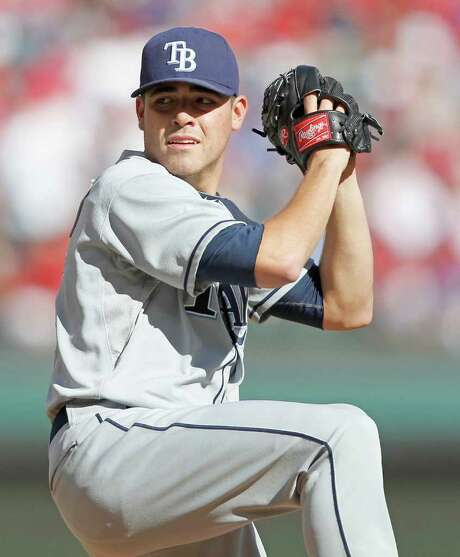 RONALD MARTINEZ : GETTY IMAGES RAYS BROUGHT MOORE: Tampa Bay's Matt Moore pitches seven scoreless innings while allowing only two hits as the Rays took a 1-0 series lead over the host Rangers. Photo: Ron Jenkins / Fort Worth Star-Telegram