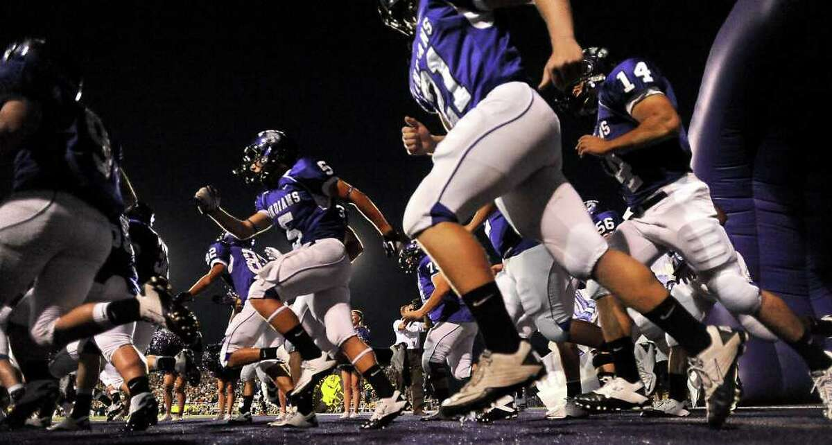 PN-G storms the field before the game against Nederland at Port Neches-Groves High School in Port Neches Friday, September 30, 2011. Tammy McKinley/The Enterprise