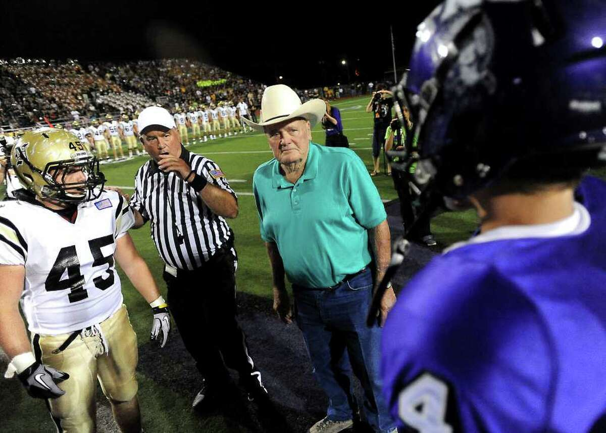 Former Houston Oilers coach, Bum Phillips is honored before the Mid-County Madness game at Port Neches-Groves High School in Port Neches Friday, September 30, 2011. Tammy McKinley/The Enterprise