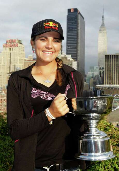 Lexi Thompson, 16, who on Sunday became the youngest player to win an LPGA tournament, poses with her trophy in New York, Tuesday, Sept. 20, 2011.  Thompson, of Coral Springs, Fla., shattered the age record for winning a multiple-round tournament when she won the Navistar LPGA Classic with a 2-under 70 Sunday in Alabama. (AP Photo/Kathy Willens) Photo: Kathy Willens / AP
