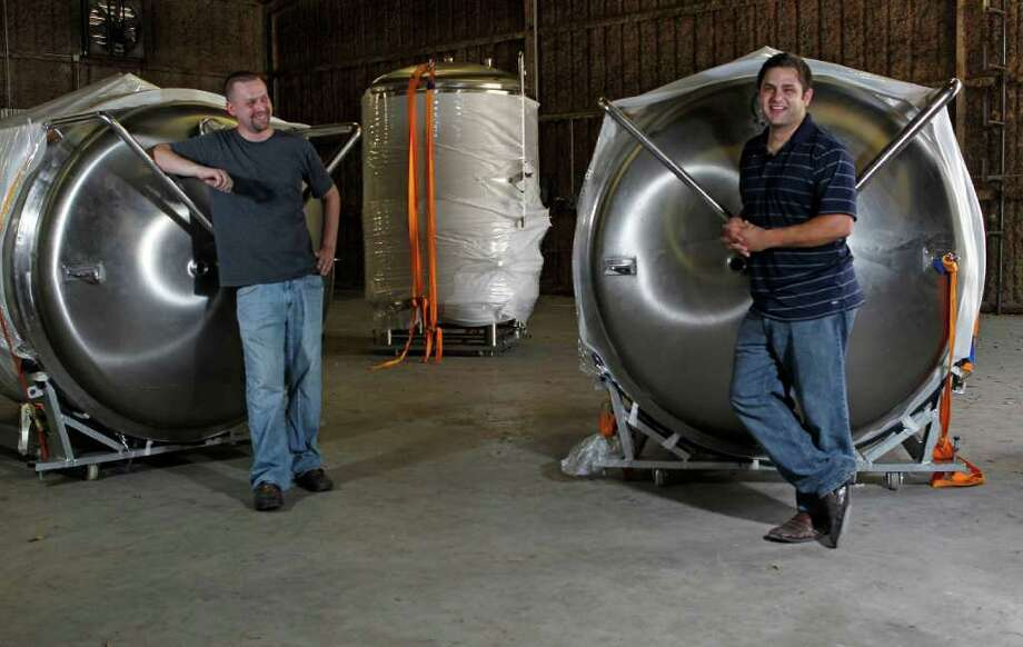 "Brewmaster Ryan Robertson, left, and founder and CEO Rassul Zarinfar expect to begin selling their first beer, a ""copper ale,"" by year's end. Photo: James Nielsen / © 2011 Houston Chronicle"
