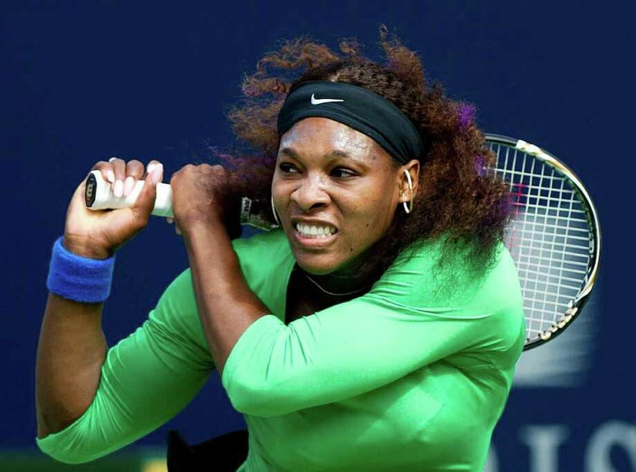 NATHAN DENETTE : ASSOCIATED PRESS LEFT OUT:  Serena Williams, shown here at the Rogers Cup in Toronto, will sit out the China Open after being left out of the draw. No explanation was given for leaving her out. Photo: Nathan Denette / AP2011