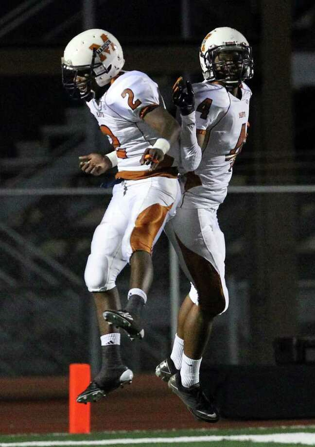 Madison's Marquis Warford (02) and Byron Daniels (04) celebrate after Daniels scored a touchdown for the Mavericks against Johnson in the first half of football at Comalander Stadium on Friday, Sept. 30, 2011. Madison defeated Johnson, 42-17. Kin Man Hui/kmhui@express-news.net Photo: Kin Man Hui, -- / San Antonio Express-News
