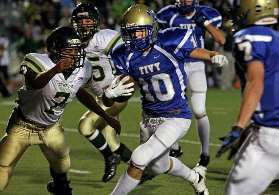 Antler receiver Kason Fornes is captured downfield after a reception by linebacker Will Ramirez as Kerrville Tivy plays McCollum in Kerrville on  September 30, 2011.  Tom Reel/Staff Photo: TOM REEL, Express-News / © 2011 San Antonio Express-News