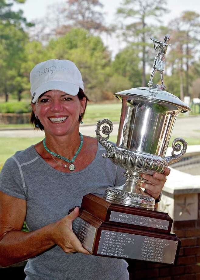 9/30/11: Eight time Women's City Amateur Champion, Robin Burke hold the championship trophy at Memorial Park Golf Course. For the Chronicle: Thomas B. Shea Photo: For The Chronicle:  Thomas B. Sh, For The Chron: Thomas B. Shea
