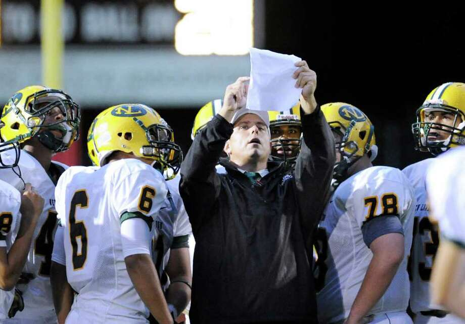 New London High School head football coach Jeff Larson, center, with his team during game between New London High School and Greenwich High School at Greenwich, Friday night, Sept. 30, 2011.  New London defeated Greenwich 51-33. Photo: Bob Luckey / Greenwich Time