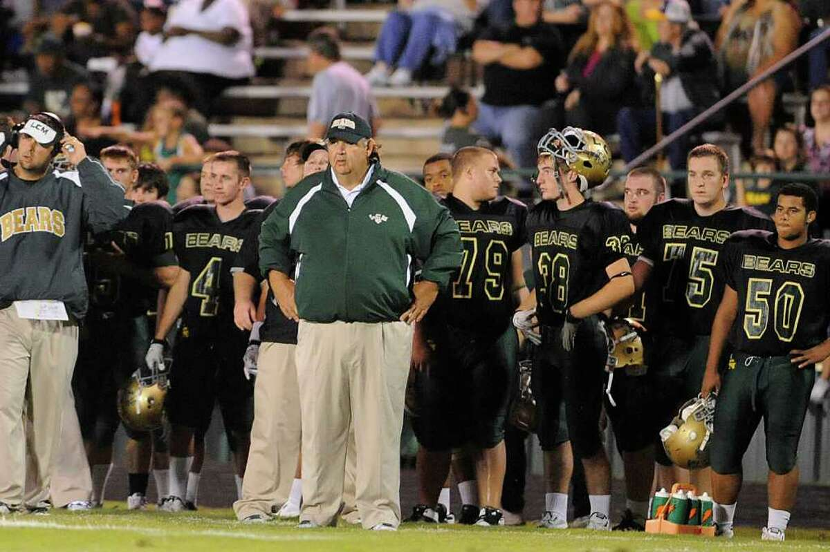 Little Cypress-Mauriceville head football coach Randy Crouch, center, watches the action in the first half against the Ozen Panthers in their district game at Bear Stadium. Friday, September 30, 2011. Valentino Mauricio/The Enterprise