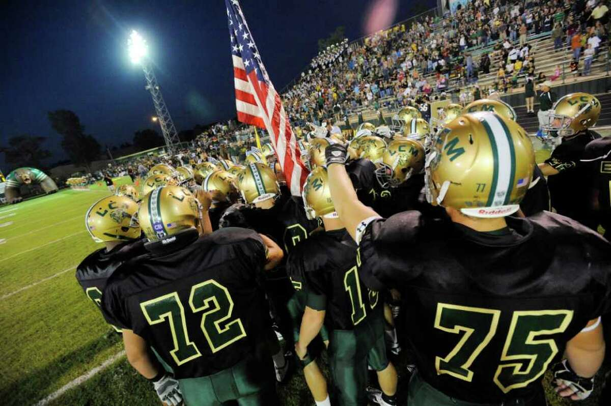 The Little Cypress-Mauriceville football team takes the field against the Ozen Panthers at Bear Stadium for their district game on Friday. September 30, 2011. Valentino Mauricio/The Enterprise