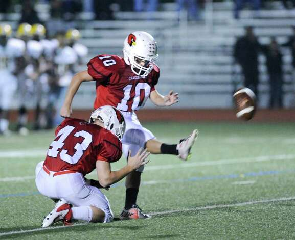 Greenwich High School kicker Jesse Adelberg, # 10 in action kicking an extra point during High School football game between New London High School and Greenwich High School at Greenwich, Friday night, Sept. 30, 2011.  New London defeated Greenwich 51-33.  Holding on the play is Mike Longo, # 43. Photo: Bob Luckey / Greenwich Time