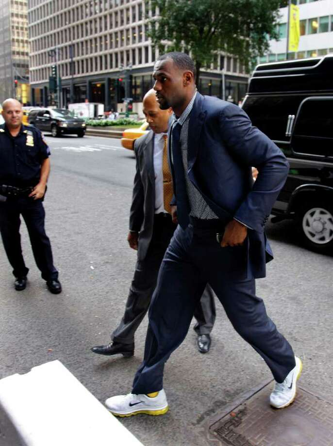 Miami Heat's LeBron James arrives for a meeting with  National Basketball Association, on Friday, Sept. 30, 2011 in New York. The owners' labor relations committee and the union's executive committee are meeting.  (AP Photo/Bebeto Matthews) Photo: Bebeto Matthews