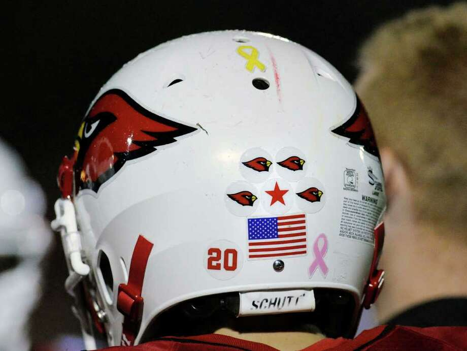 The Cardinal helmet of Shawn Dunster, # 20, during High School football game between New London High School and Greenwich High School at Greenwich, Friday night, Sept. 30, 2011. Photo: Bob Luckey / Greenwich Time