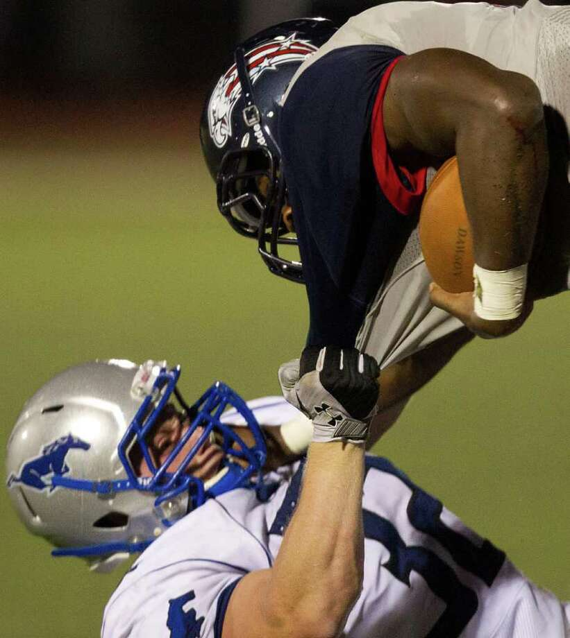 Dawson running back James White (2) is brought down by Friendswood linebacker Logan Varner (32) during the second quarter. Photo: Smiley N. Pool, Houston Chronicle / © 2011  Houston Chronicle