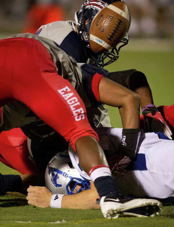 The ball gets away for a turnover as Friendswood quarterback Jordon Wood (8) fumbles during the third quarter. Photo: Smiley N. Pool, Houston Chronicle / © 2011  Houston Chronicle