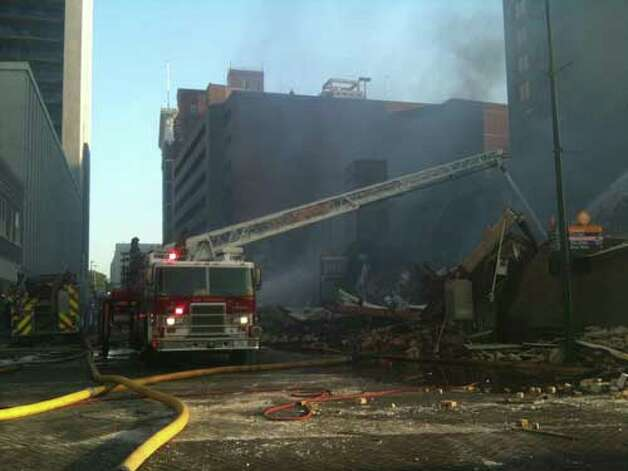 Fire destroys historic Bell building at East Commerce and Main Street.
