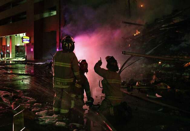 San Antonio fire fighters respond to a massive  fire destroying Main Street Ballroom, Poblano's Restaurant and Meat Market Barbeque Restaurant. Photo: BOB OWEN, BOB OWEN/rowen@express-news.net / rowen@express-news.net
