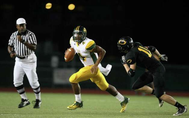 Klein Forest's Matt Davis (4) looks for running room past Klein Oak's Austin Ondrej during the first half of their matchup, Friday at Memorial Stadium in Klein. Photo: Eric Christian Smith, For The Chronicle