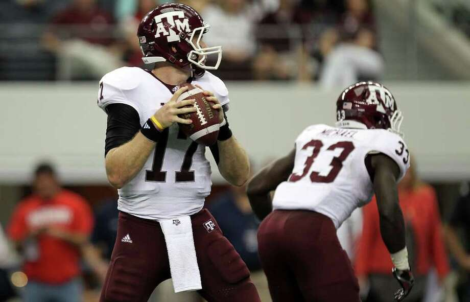 ARLINGTON, TX - OCTOBER 01:  Quarterback Ryan Tannehill #17 of the Texas A&M Aggies throws against the Arkansas Razorbacks at Cowboys Stadium on October 1, 2011 in Arlington, Texas. Photo: Ronald Martinez, Getty / 2011 Getty Images