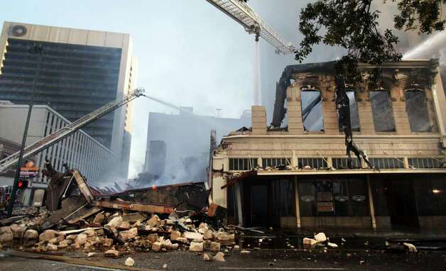 San Antonio fire fighters respond to a massive fire destroying Main Street Ballroom, Poblano's Restaurant and Meat Market Barbeque Restaurant at Main Plaza. Photo: BOB OWEN, SAN ANTONIO EXPRESS-NEWS / rowen@express-news.net