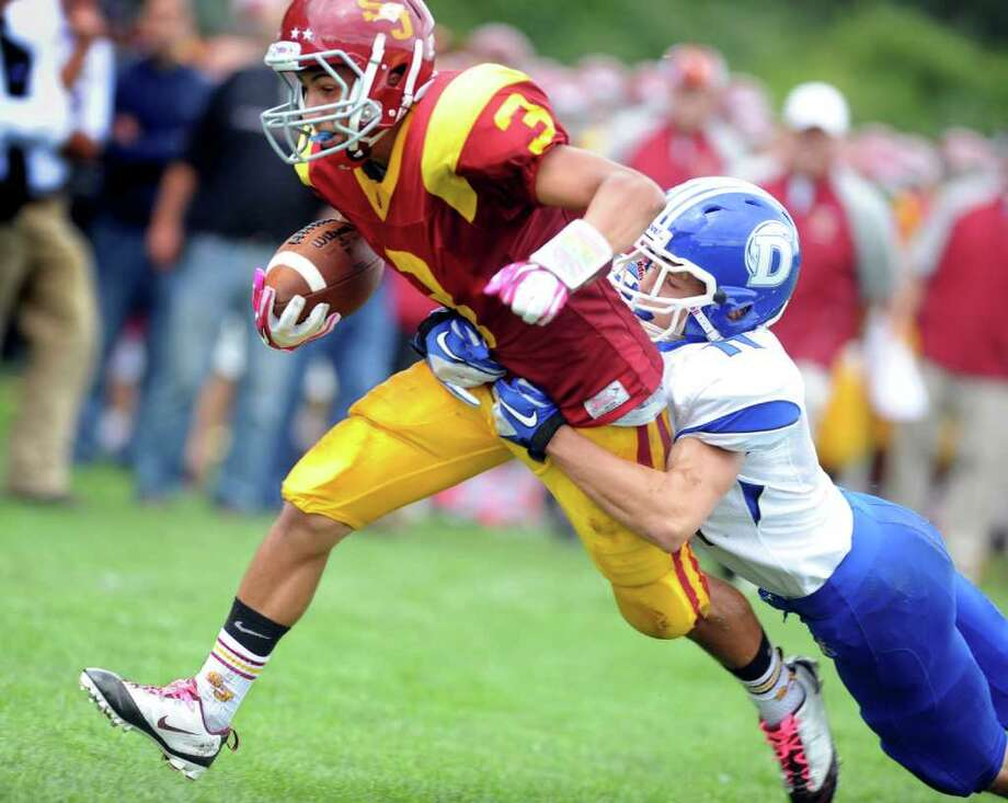 St. Joseph's Jake Pelletier scores a touchdown as Darien's Brian Wiegand tries to take him down during Saturday's game at the St. Joseph campus in Trumbull, Conn. Photo: Autumn Driscoll