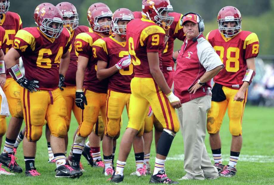 St. Joseph's head football coach Joe Della Vecchia talks to his team during Saturday's game against Darien at the St. Joseph campus in Trumbull, Conn. Photo: Autumn Driscoll