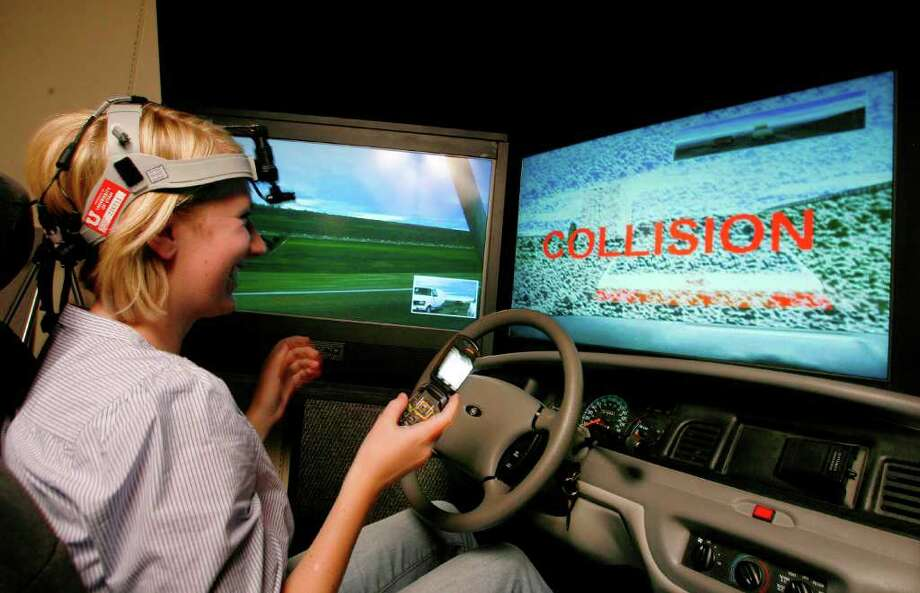 JEFFREY D. ALLRED : NEW YORK TIMES TESTING: University of Utah researchers asked volunteers like Anne McLaren to use a cellphone in a driving simulator. Talking wasn't a problem, but while texting she hit another car. Photo: Jeffrey D. Allred / NYTNS
