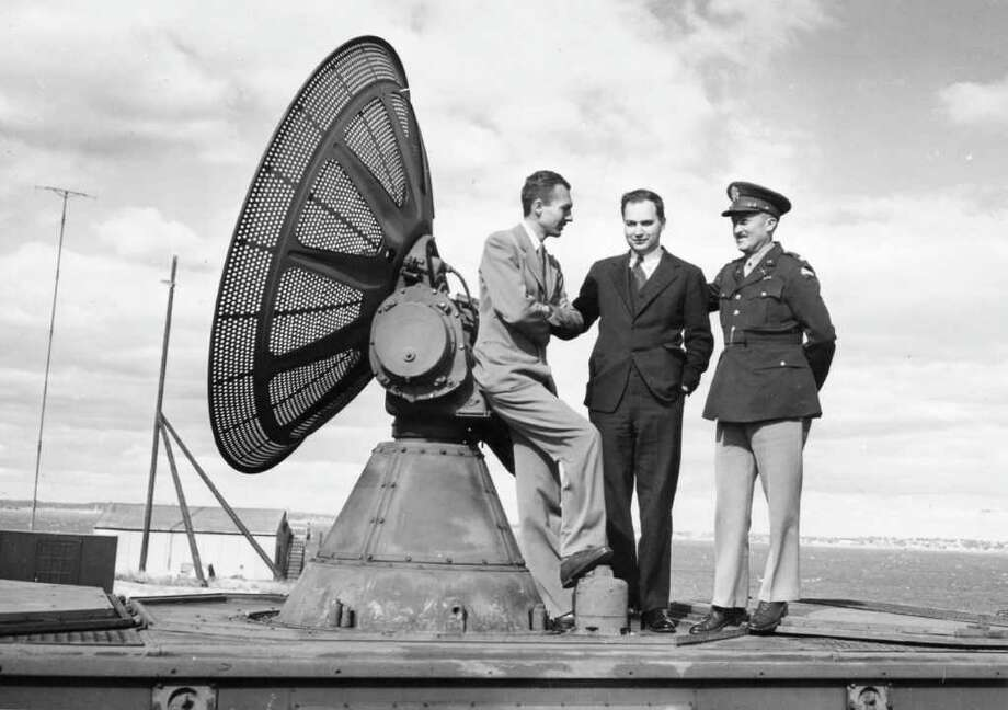 Lee Davenport, left, leaning against his radar invention, the SCR-584, in 1942, with Ivan Getting and Lt. Col. Arthur H. Warner. Davenport died Friday in Greenwich at age 95. Photo courtesy of the MIT Radiation Laboratory Photo: Contributed Photo