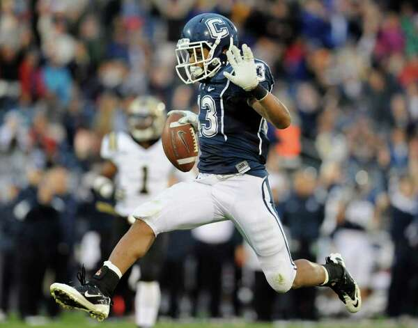 Connecticut's Lyle McCombs scores a touchdown against Western Michigan in the second half of an NCAA college football game, in East Hartford, Conn., on Saturday, Oct. 1, 2011. Photo: Jessica Hill/Associated Press / AP2011