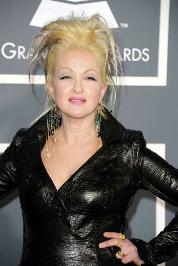 Singer Cyndi Lauper arrives at The 53rd Annual Grammy Awards in Los Angeles in February. Lauper and her husband, David Thornton, were seen having dinner on the patio of Mediterraneo restaurant on Greenwich Avenue last weekend. (Photo by Jason Merritt/Getty Images) Photo: Jason Merritt, Getty Images / 2011 Getty Images