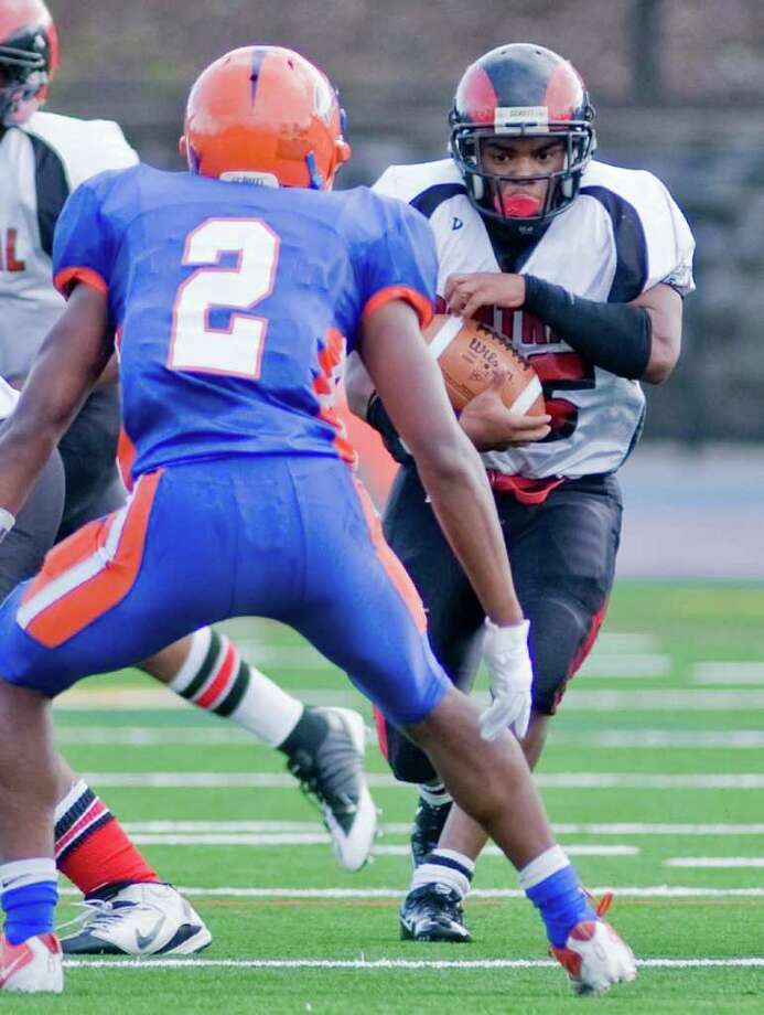 Bridgeport Central High School player Frederick Tucker runs with the ball during a football game against Danbury High School, at Danbury. Saturday, Oct. 1, 2011 Photo: Scott Mullin / The News-Times Freelance