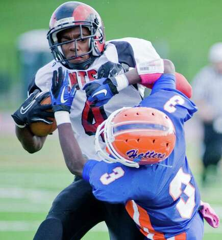 Bridgeport Central High School's Chad Lawrence tries to run through Danbury High School player James Harrington in a football game at Danbury. Saturday, Oct. 1, 2011 Photo: Scott Mullin
