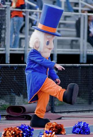 The Danbury High School mascot dances during a football game against Bridgeport Central High School, held at Danbury. Saturday, Oct. 1, 2011 Photo: Scott Mullin / The News-Times Freelance