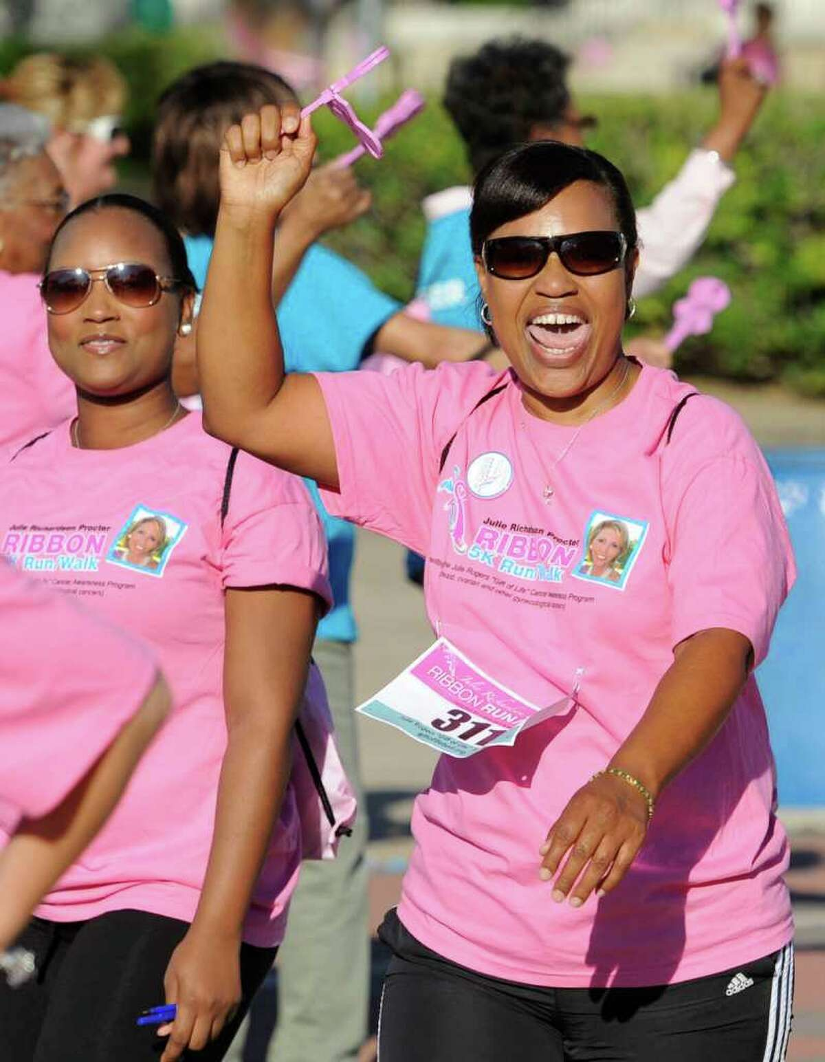 Jubilant walkers approach the finish line on Main Street in downtown Beaumont during the Julie Richardson Procter 5K Ribbon Run/Walk on Saturday, October 1, 2011. Valentino Mauricio/The Enterprise