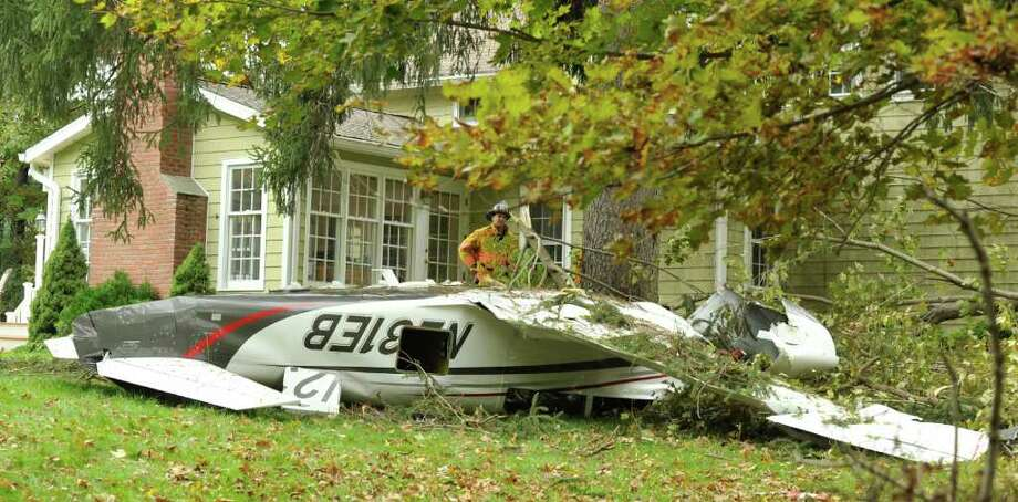 A plane crashed in front of a home on Briar Ridge Road in Ridgefield Saturday, Oct. 1, 2011. Photo: Michael Duffy
