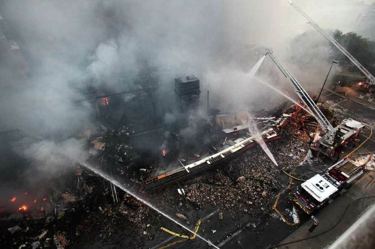 San Antonio fire fighters respond to a massive fire destroying the Main Street Ballroom, Poblano's Restaurant and Meat Market Barbeque Restaurant at in downtown San Antonio, Texas on Saturday, Oct. 1, 2011. (AP Photo/San Antonio Express-News, Bob Owen)