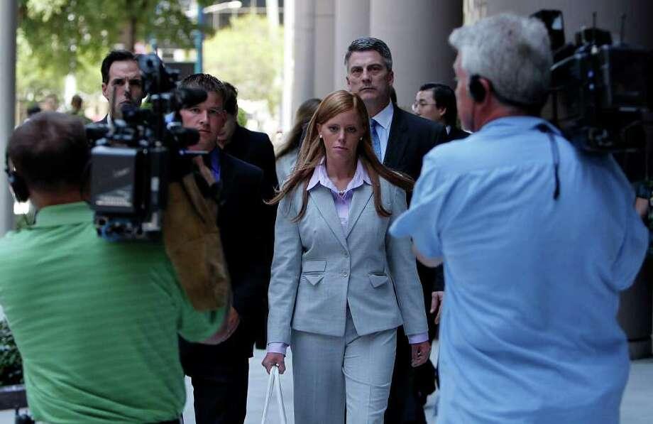 Husband Kallan Daigle was beside her and attorney Todd Kelly was behind her when Jamie Leigh Jones' civil trial against KBR got under way June 14 in Houston. Photo: Johnny Hanson / © 2011 Houston Chronicle