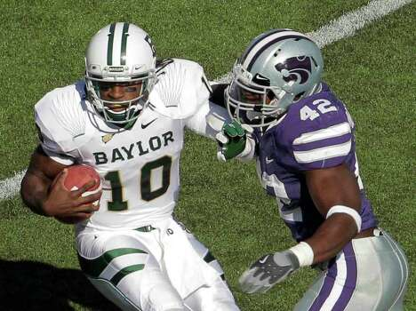Baylor quarterback Robert Griffin III (10) is sacked by Kansas State defensive end Meshak Williams (42) during the second quarter of an NCAA college football game Saturday, Oct. 1, 2011, in Manhattan, Kan. (AP Photo/Charlie Riedel) Photo: Charlie Riedel / AP