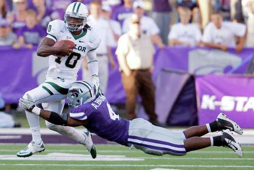 Kansas State Wildcats linebacker Arthur Brown (4) stretches out to stop Baylor Bears quarterback Robert Griffin III (10) in the 4th quarter, Saturday, October 1, 2011 in Manhattan, Kansas. Kansas State defeated Baylor, 36-35. (Bo Rader/Wichita Eagle/MCT) Photo: Bo Rader / Wichita Eagle