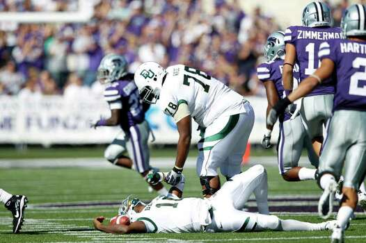 MANHATTAN, KS - OCTOBER 1: Robert Griffin III #10 of the Baylor Bears lays on the field after being sacked during the game against the Kansas State Wildcats at Bill Snyder Family Football Stadium on October 1, 2011 in Manhattan, Kansas. The Wildcats won 36-35. (Photo by Joe Robbins/Getty Images) Photo: Joe Robbins / 2011 Getty Images